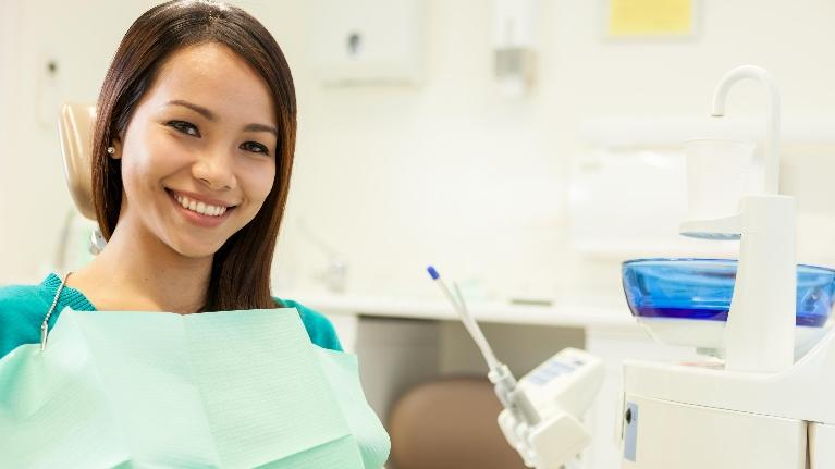 Girl in dental chair | oral surgery Northport NY